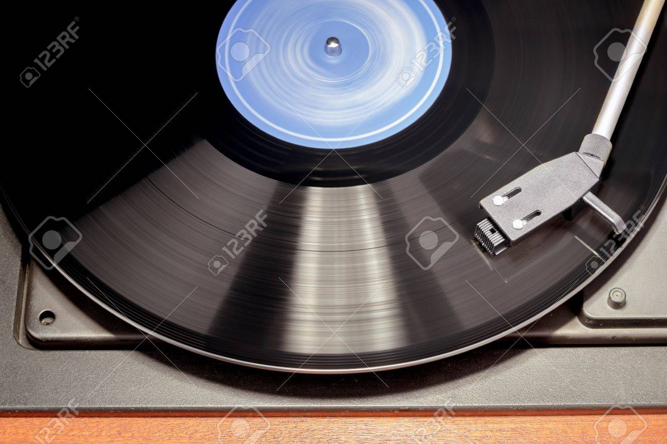 Detail of vintage record player with spinning vinyl. Motion blur image. - 16725931