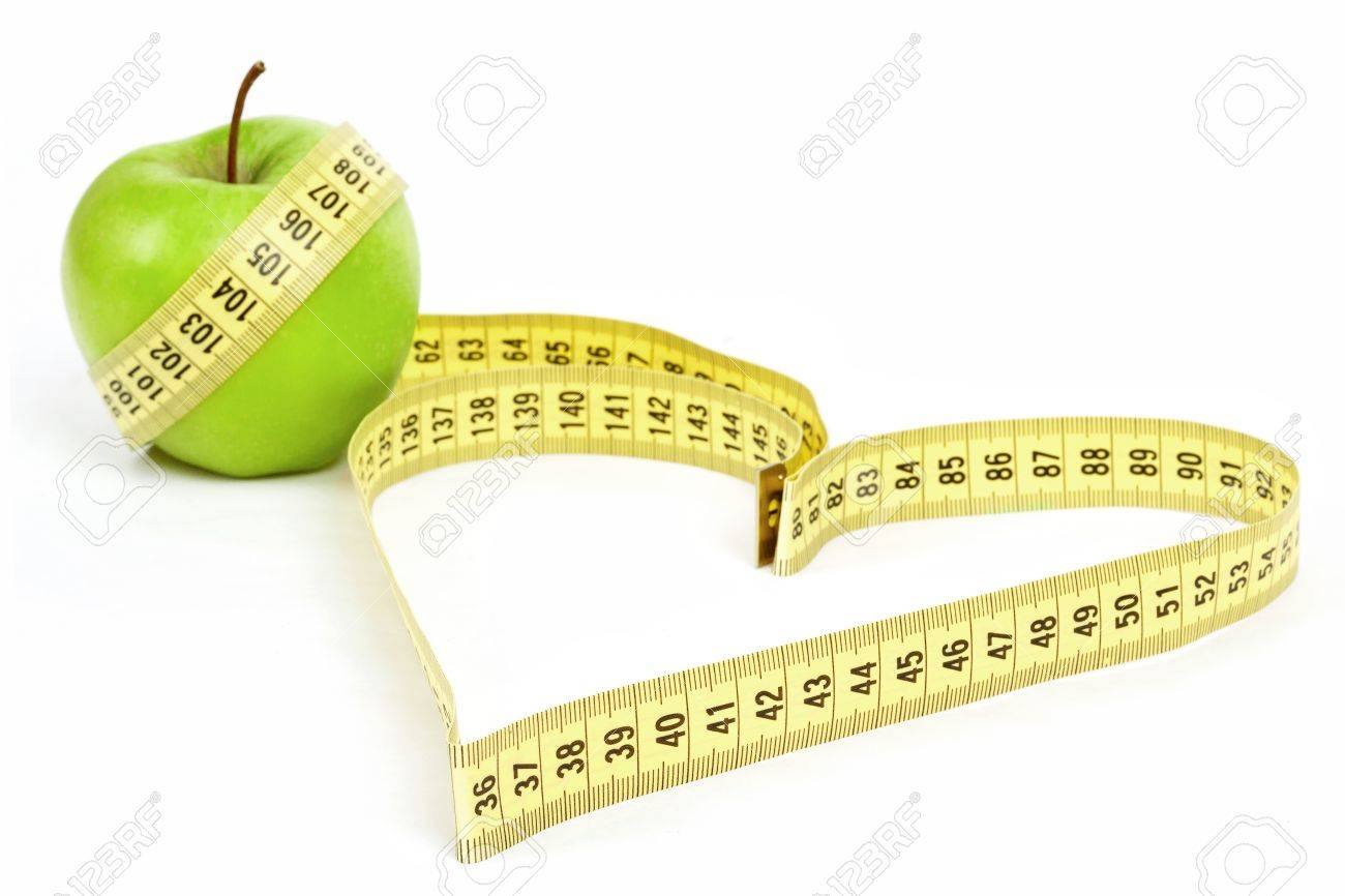 Tape measure heart shape and green apple - health, weight concept - 17777368