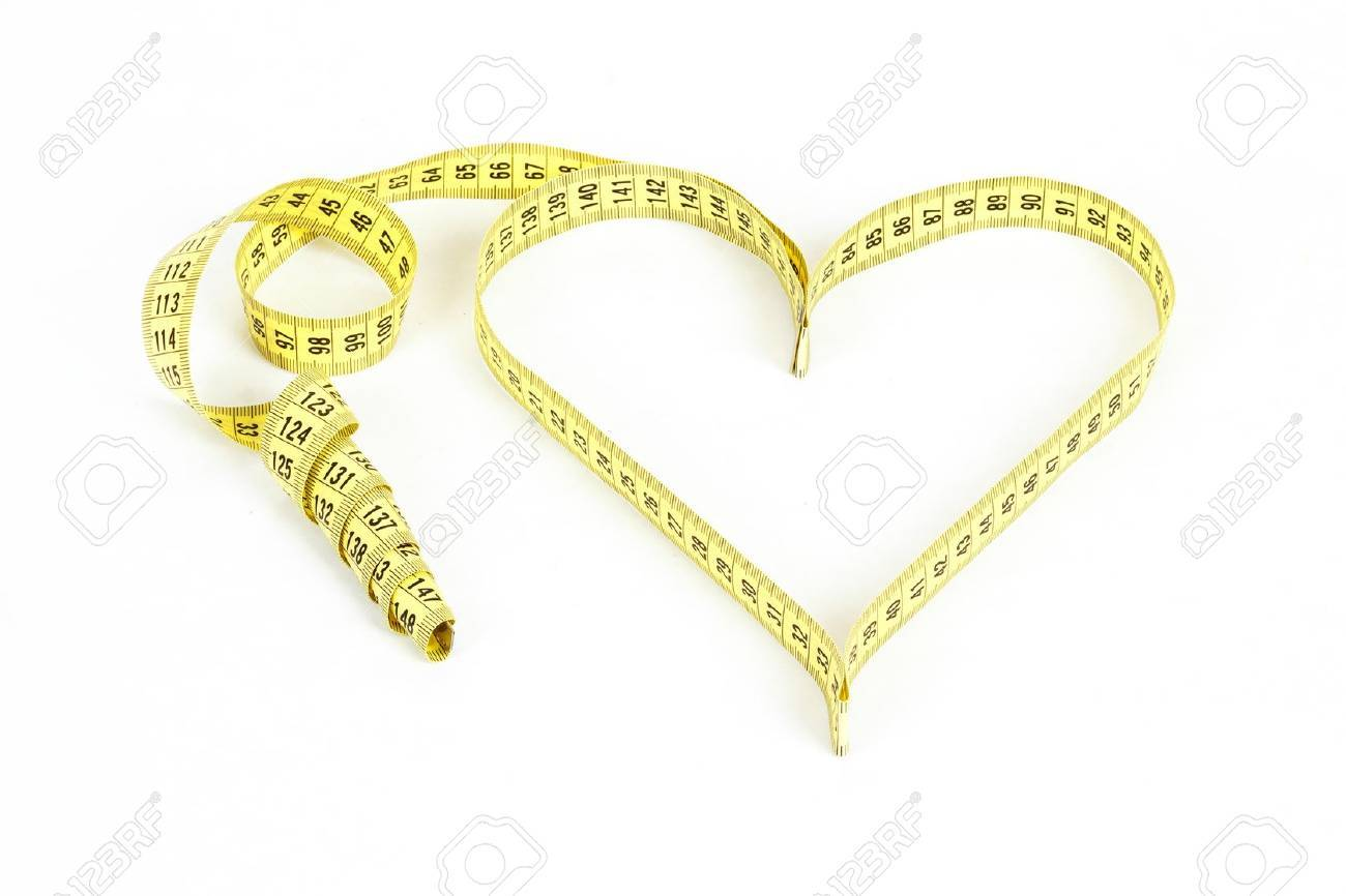 A measuring tape shaping a heart isolated on white background - 17934498