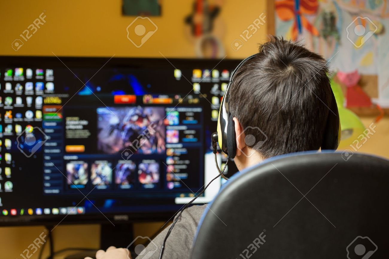 Teenager using computer at home with headphones, play game in his child room - 38483634