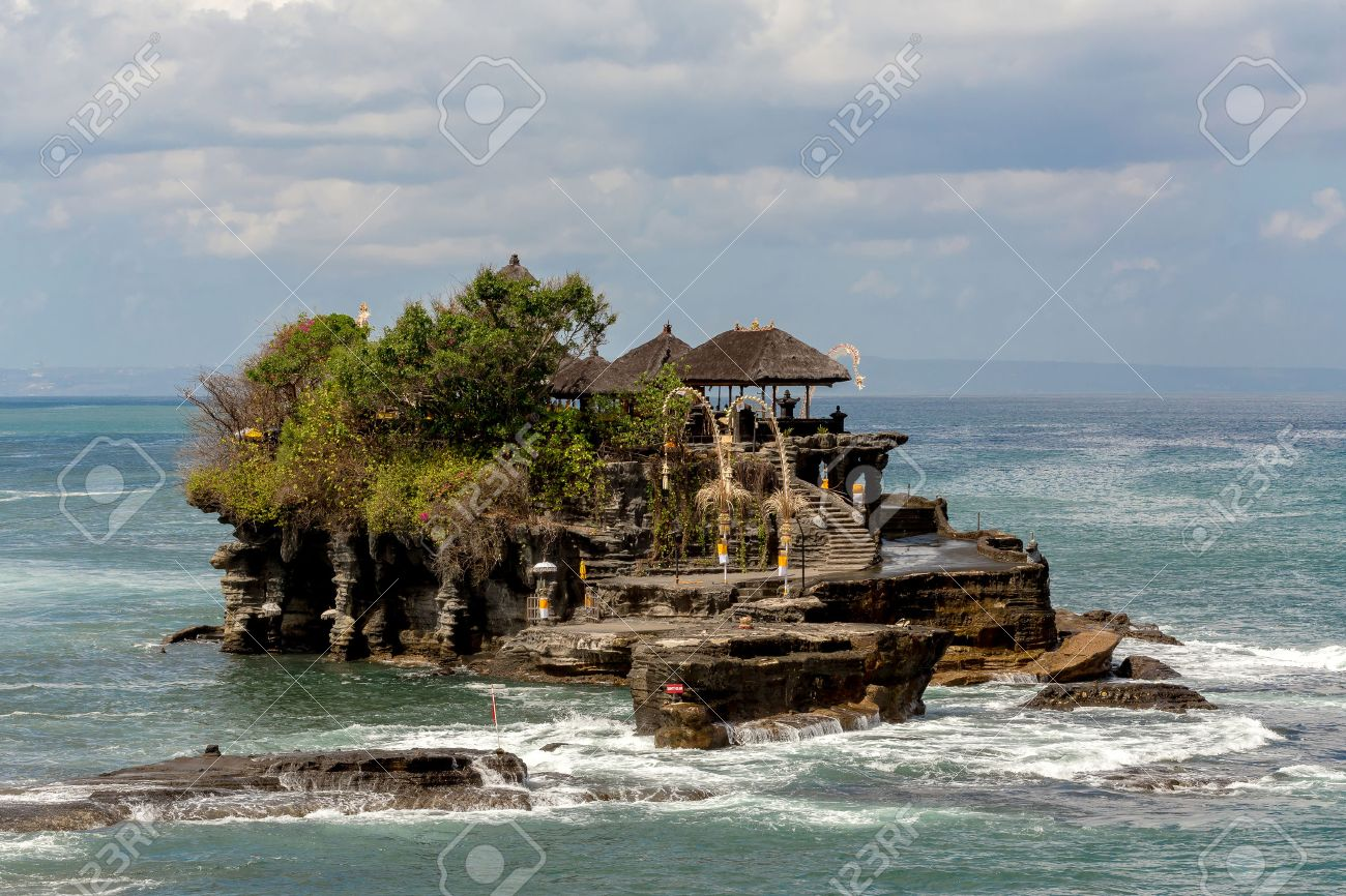 famous Tanah Lot Temple on Sea in Bali Island Indonesia with blue sky and waves - 46618714