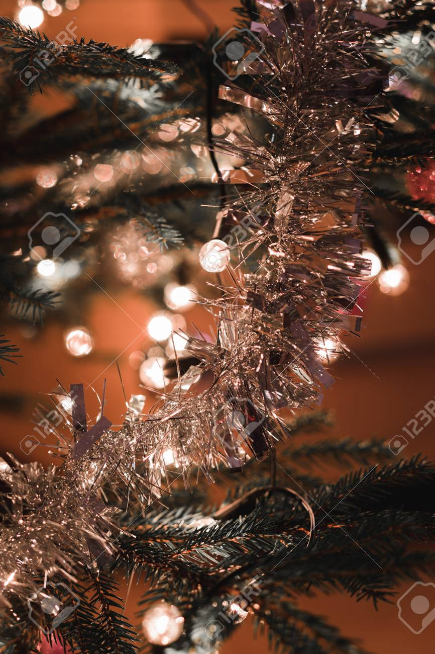 Detail Of Christmas Decoration On Tree With Light, Snowfall Effect ...