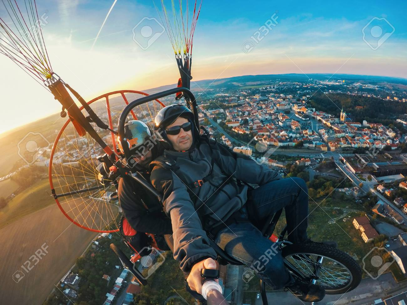 Powered paragliding tandem flight, man taking selfie with action