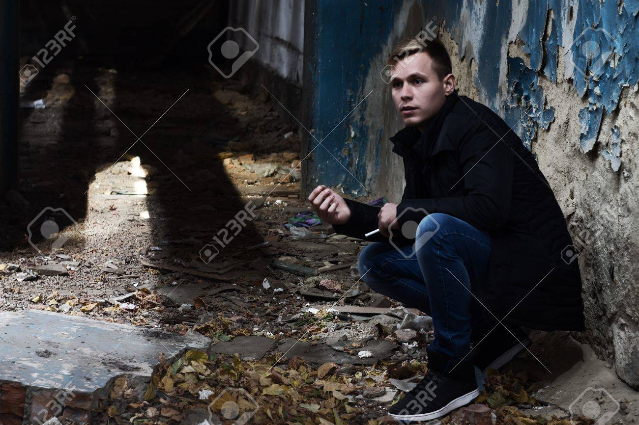 Young Man In Squatting Position In Abandoned Building Stock Photo Picture And Royalty Free Image Image 51705357