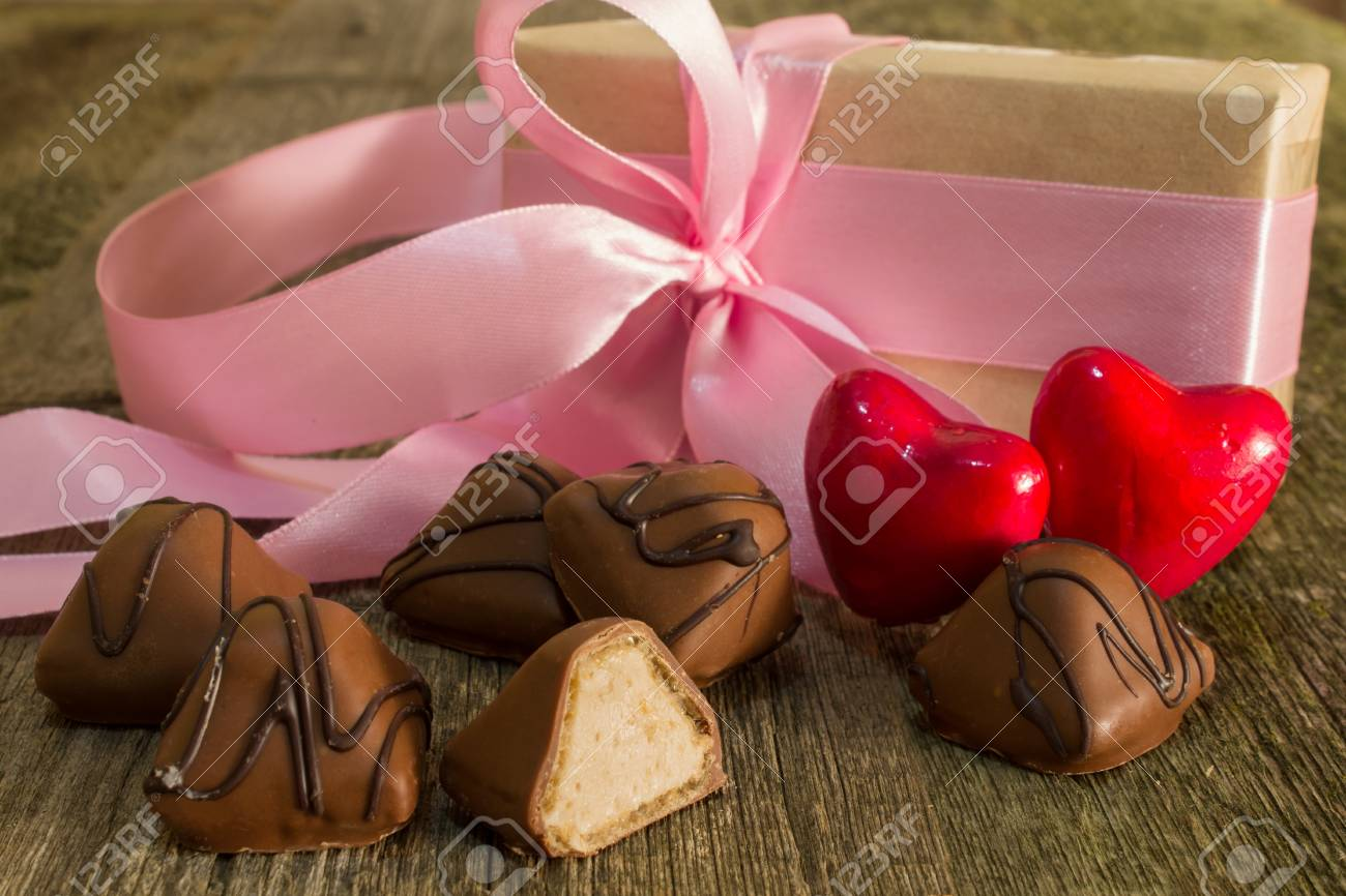 Two Red Hearts And Chocolate Candies With A Gift Bandaged Pink ...