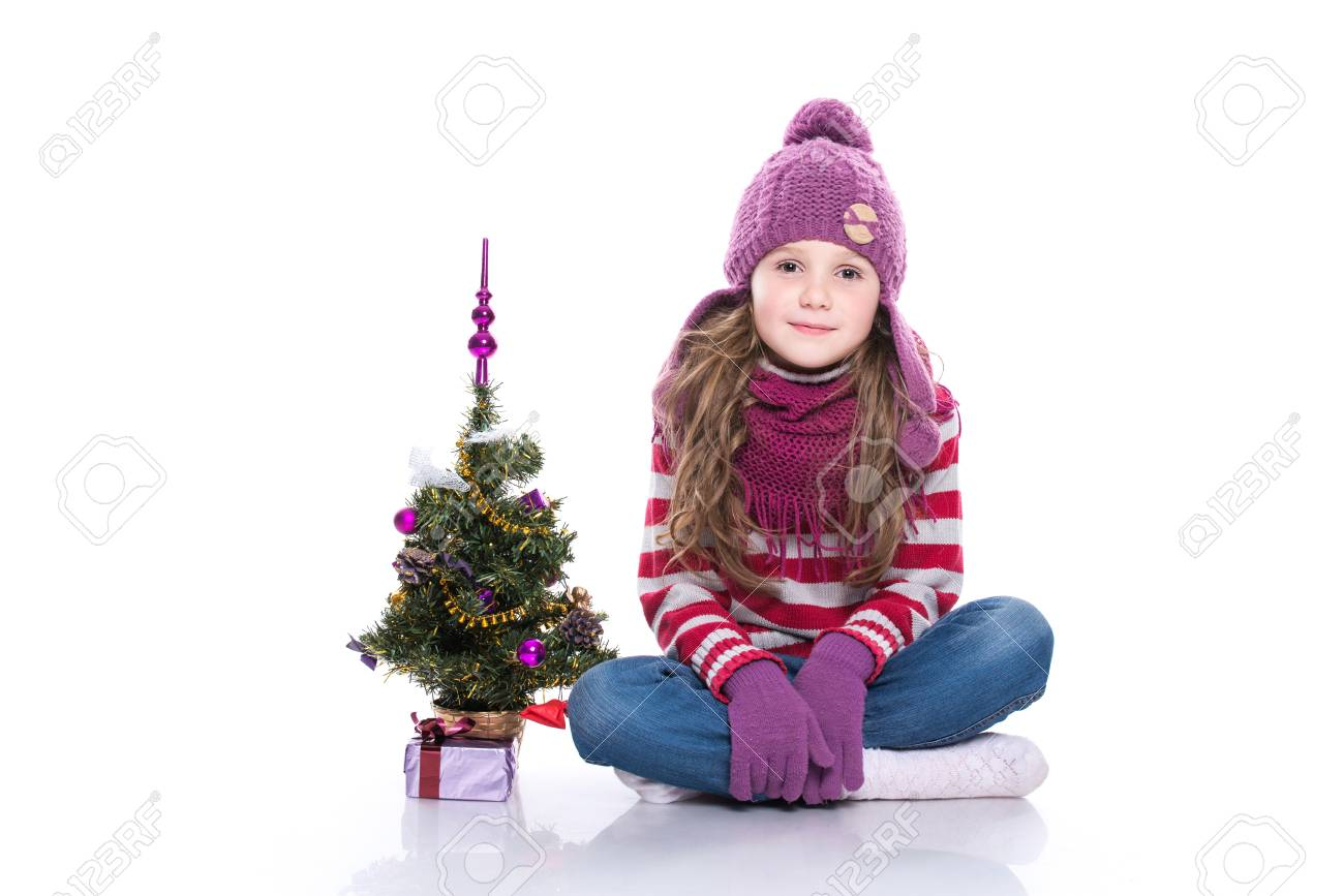 00cd9ddb5 Cute Smiling Little Girl Wearing Purple Knitted Scarf And Hat ...