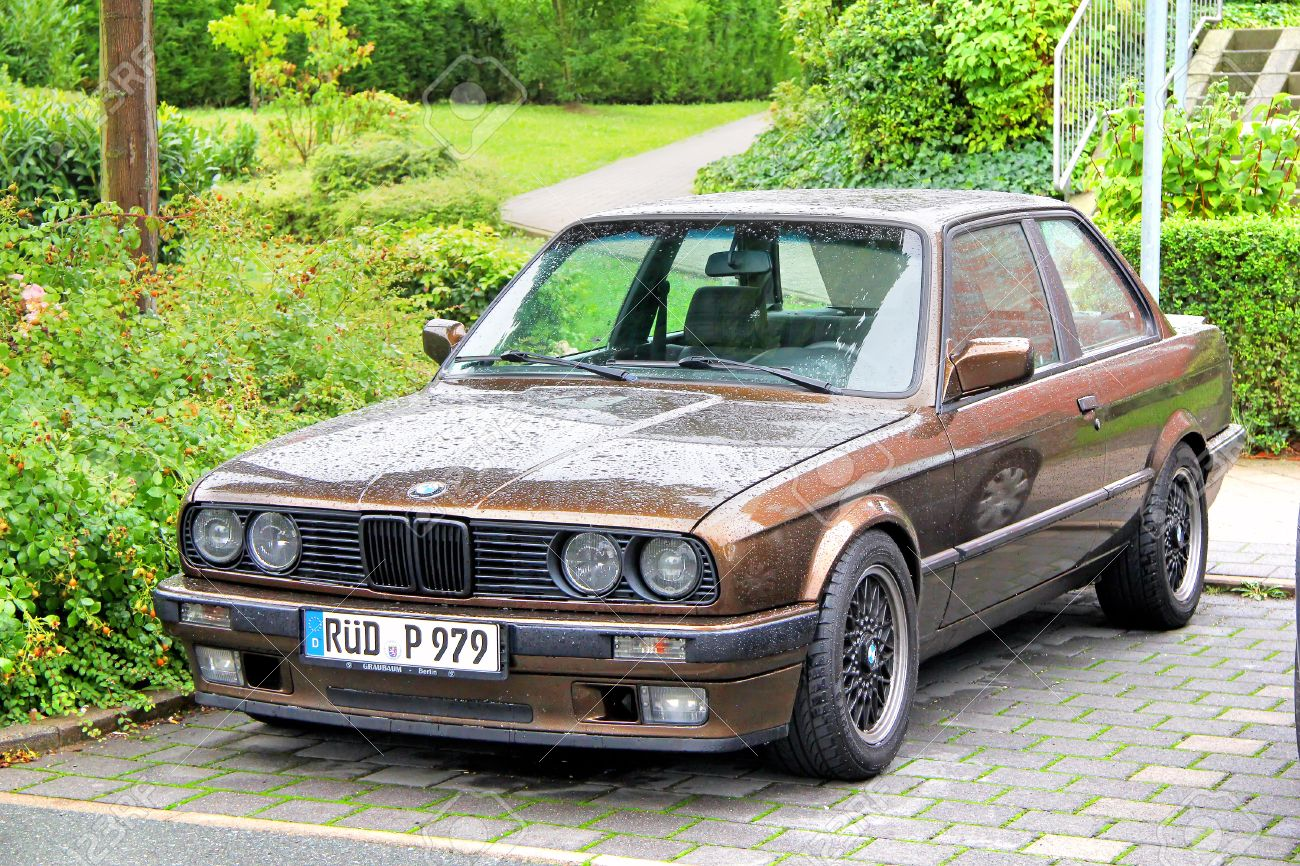 BMW Convertible bmw retro car FRANKFURT AM MAIN, GERMANY - SEPTEMBER 16, 2013 Brown BMW E30 ...