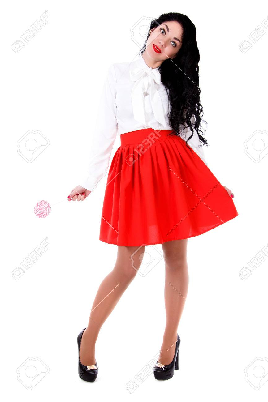 1a5de3bc561c Beautiful young woman in a white blouse and a red skirt isolated over white  background Stock
