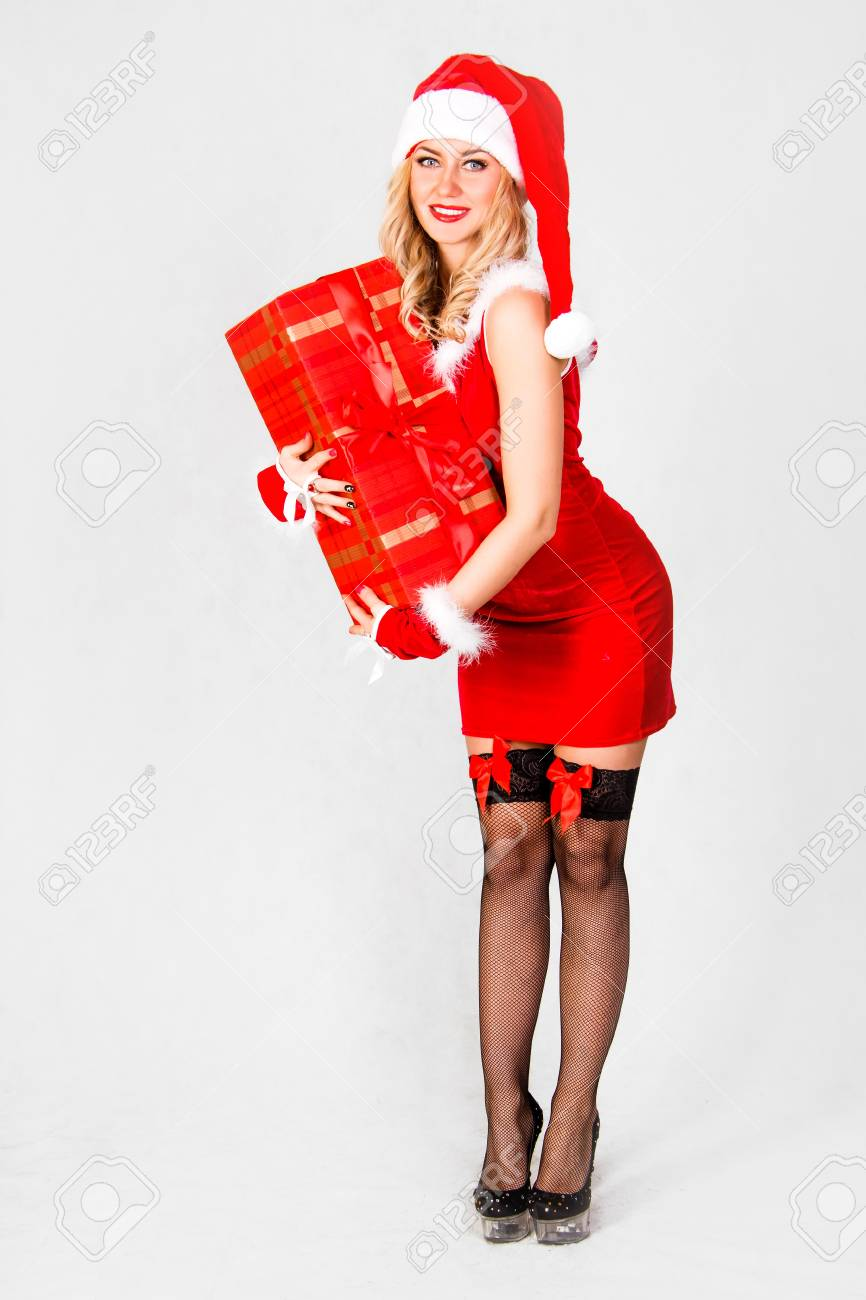 a95cfcd55c93 Beautiful young woman in a Christmas clothes over grey background Stock  Photo - 49697597