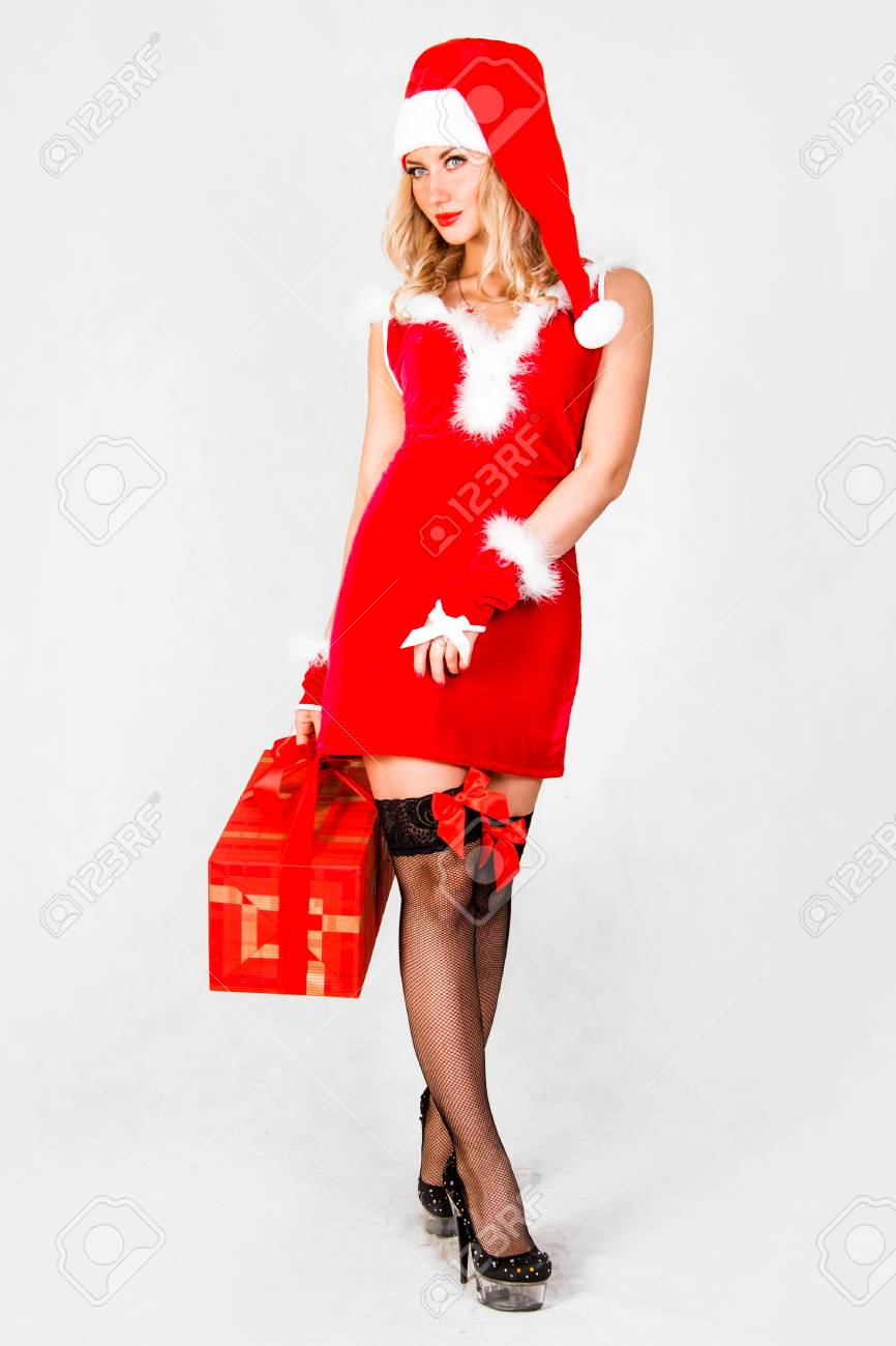a29aede8676d Beautiful young woman in a Christmas clothes over grey background Stock  Photo - 64686051