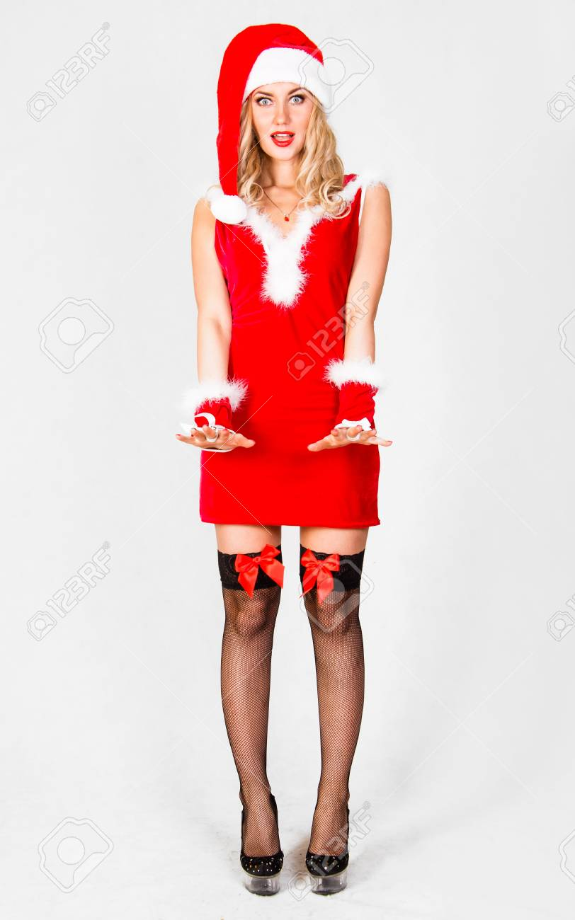 04dabc1ae7cd Beautiful young woman in a Christmas clothes over grey background Stock  Photo - 64686040