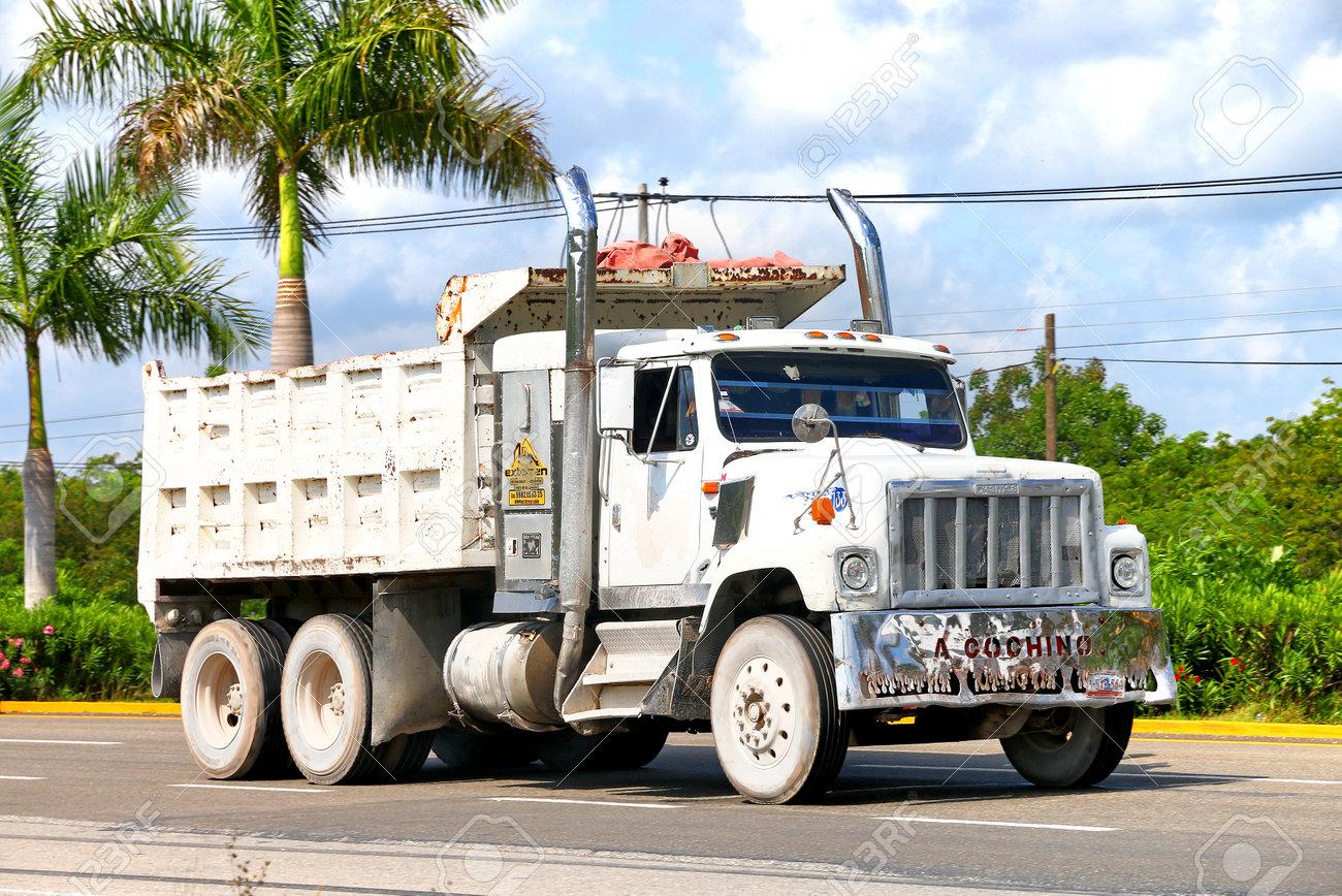 Quintana Roo, Mexico - May 16, 2017: White dump truck Famsa at
