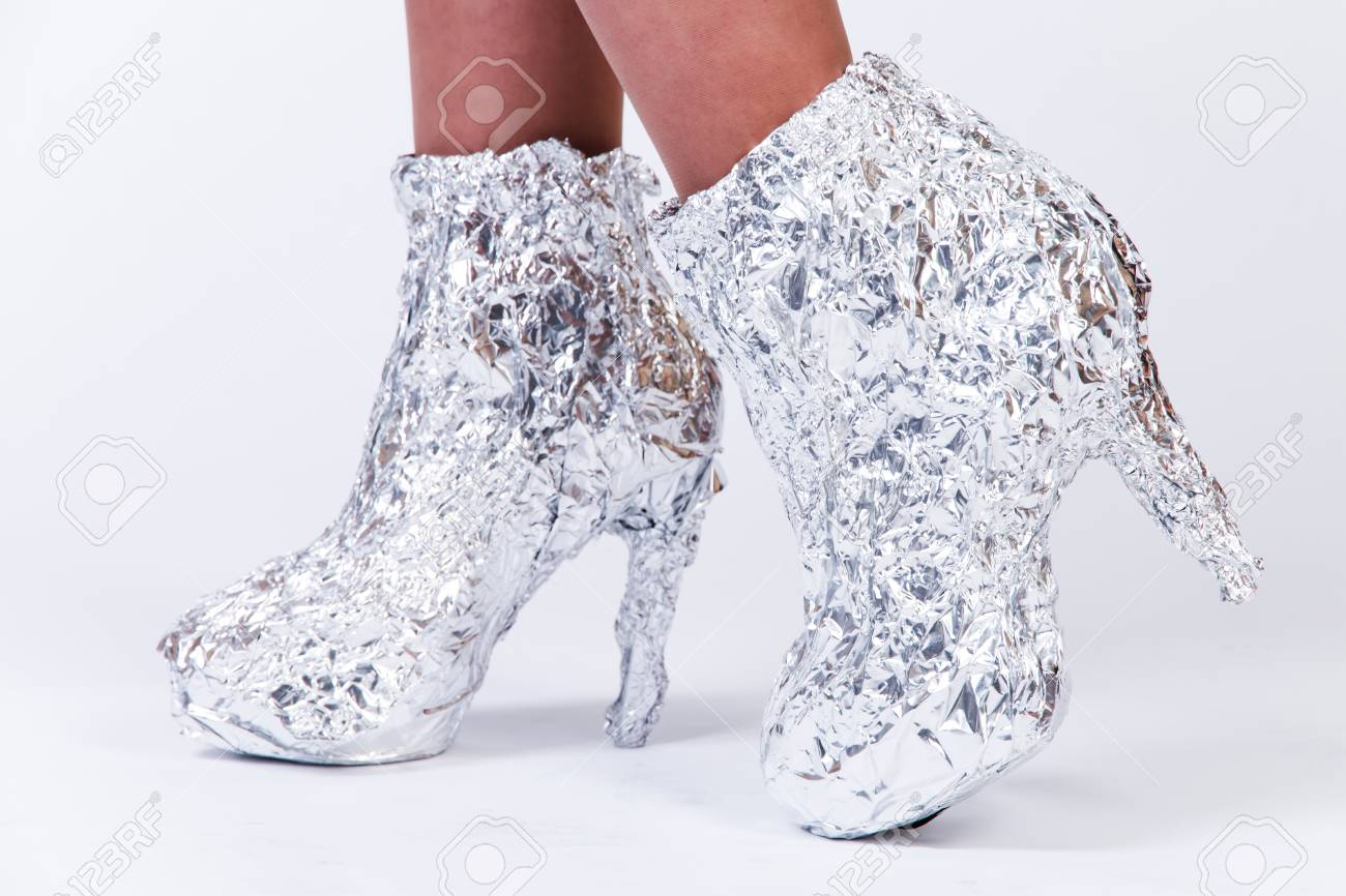 d348ef41cfcb Woman Shoes Made Of Aluminium Foil Over Grey Background Stock Photo ...