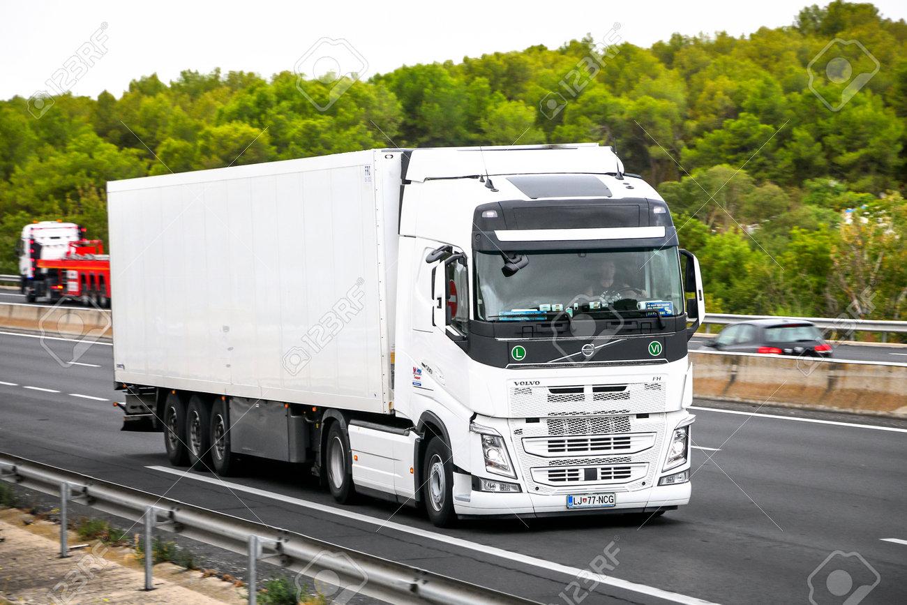 Occitanie, France - September 10, 2019: White semi-trailer truck Volvo FH12.500 at the interurban road. - 134563431