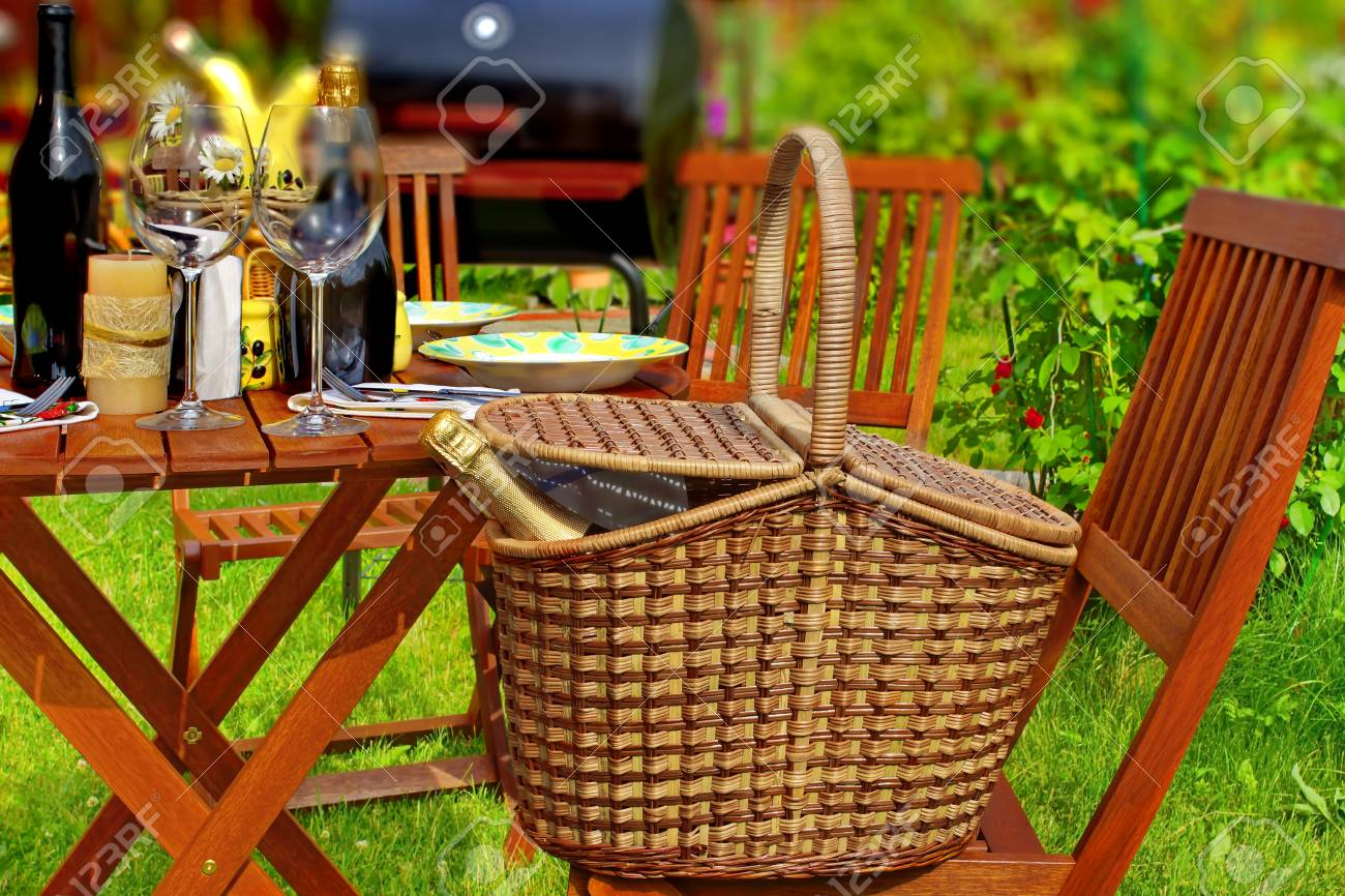 Summer Party Or Picnic Scene. Basket With Sparkling Wine, Wooden ...
