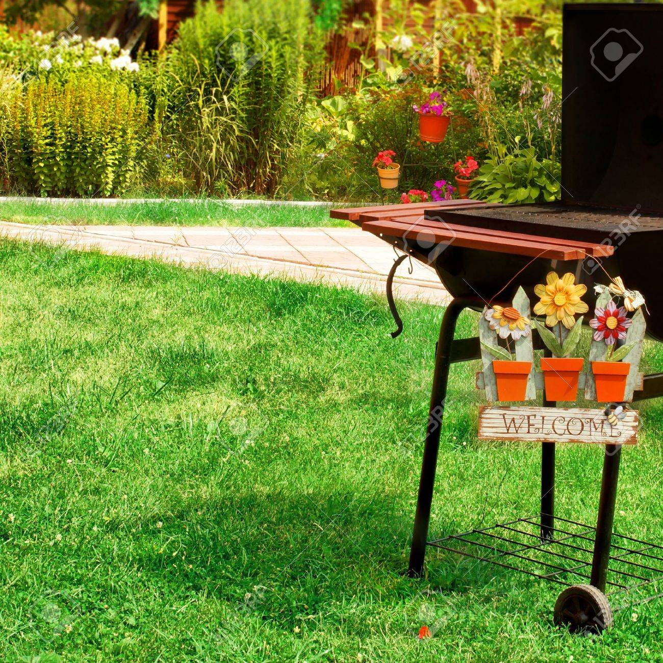 bbq grill and welcome sign in the backyard background with space