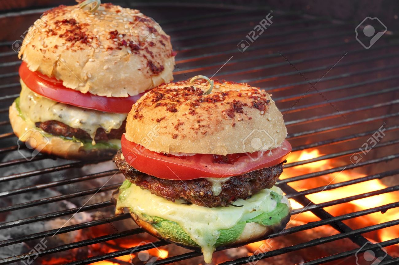 Closeup Of Homemade Burgers On Hot Bbq Charcoal Grill With Flames Stock Photo Picture And Royalty Free Image Image 42254858
