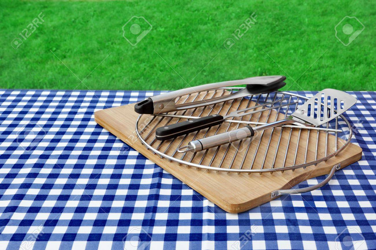 Picnic Table Covered Checkered Blue White Tablecloth And BBQ Grill With  Tools Kit, Park Lawn