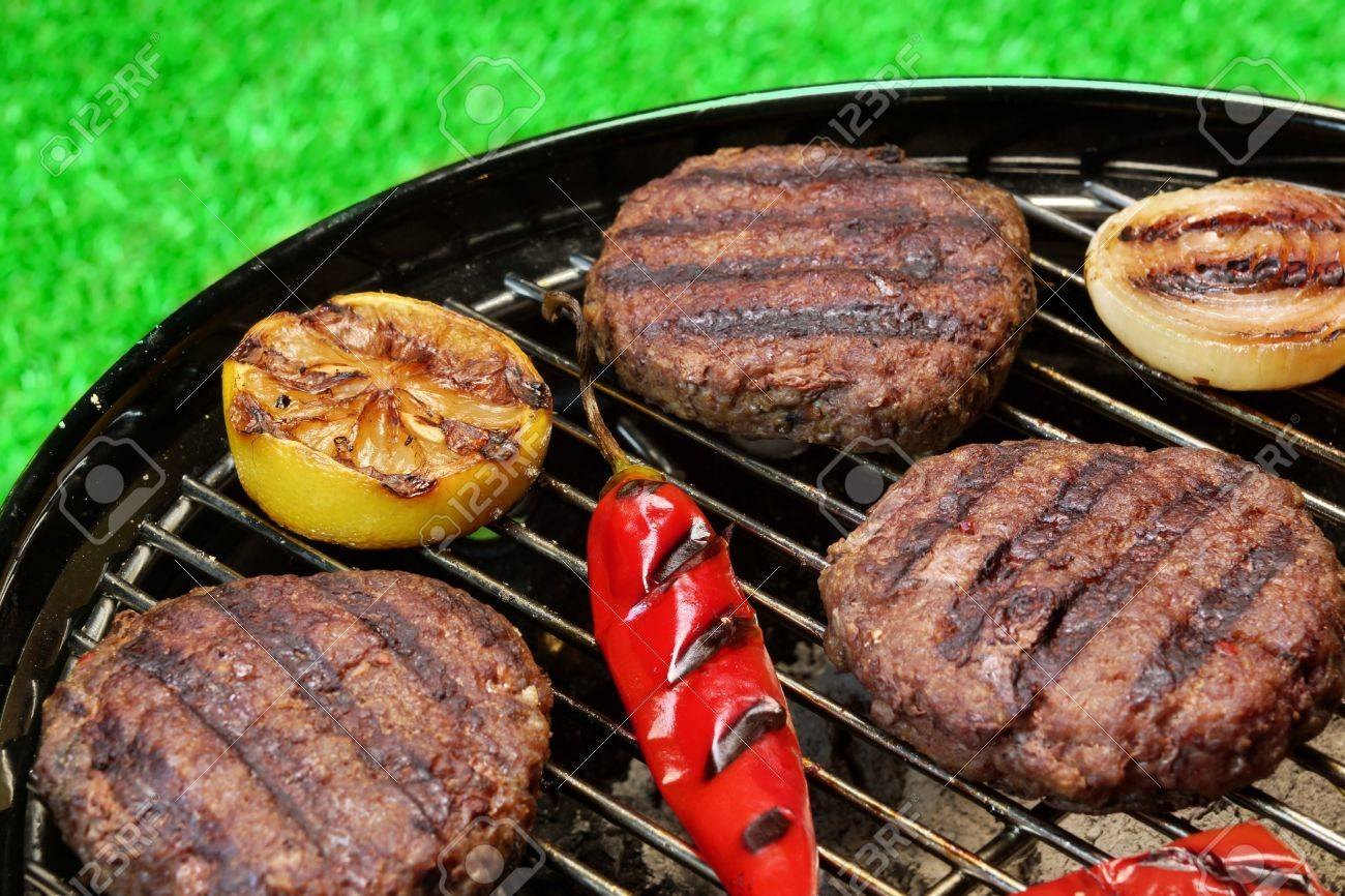 Bbq Burgers Cooked On Hot Charcoal Grill With Vegetables Cookout Stock Photo Picture And Royalty Free Image Image 46262589
