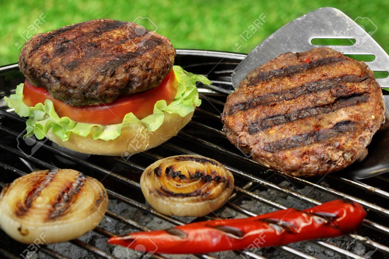 Spatula And Barbecue Burgers On The Hot Charcoal Grill Cookout Stock Photo Picture And Royalty Free Image Image 46265589