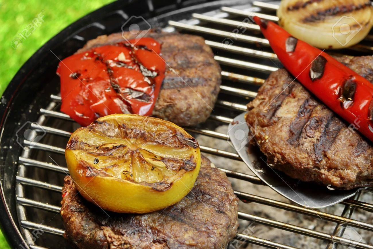Spatula And Barbecue Burgers On The Hot Charcoal Grill Cookout Stock Photo Picture And Royalty Free Image Image 46267545