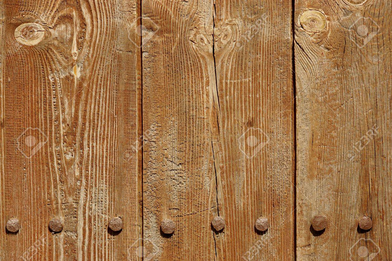 Old Brown Wood Plank Panel With Forged Rusty Iron Nails Close Up Texture Background Stock