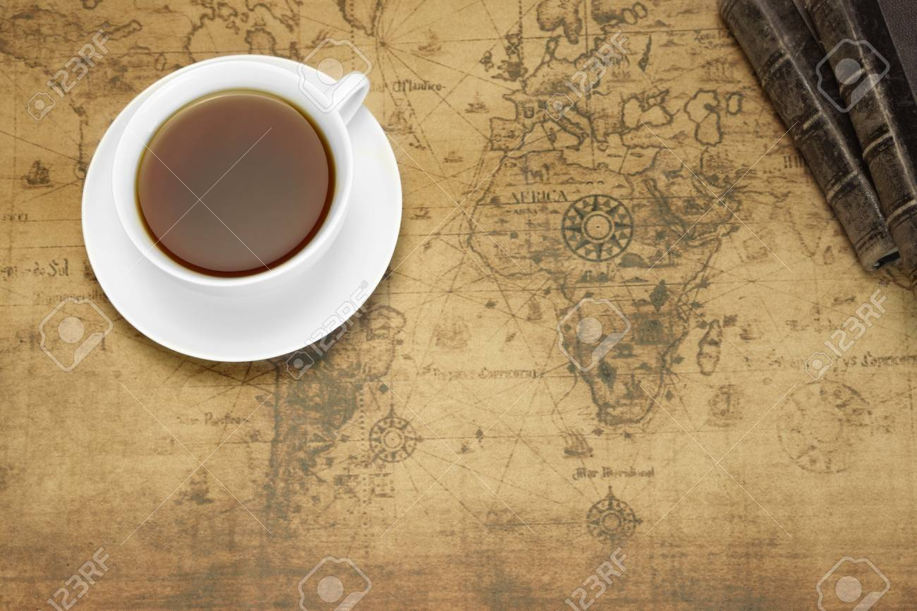 White tea cup on the old world map background overhead view white tea cup on the old world map background overhead view travel or adventure gumiabroncs Images