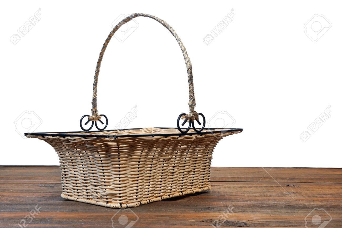 White wicker baskets with handle - Empty Vintage Wicker Basket With Metal Handle On The Brown Wooden Table Isolated On White Background