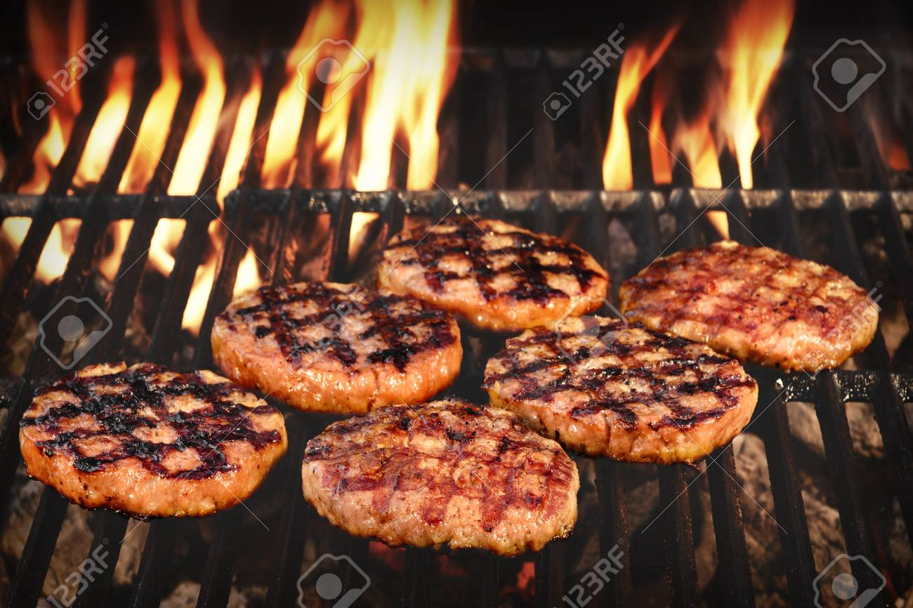 Bbq Grilled Burgers Patties On The Hot Flaming Charcoal Grill Stock Photo Picture And Royalty Free Image Image 55305672