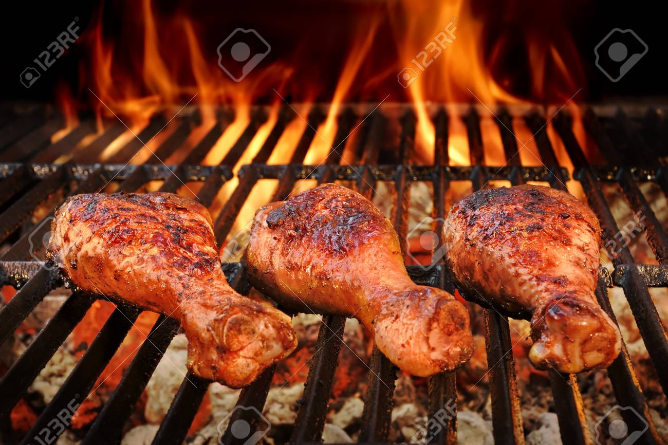 Bbq Chicken Legs Roasted On The Hot Flaming Charcoal Grill Top Stock Photo Picture And Royalty Free Image Image 55305117