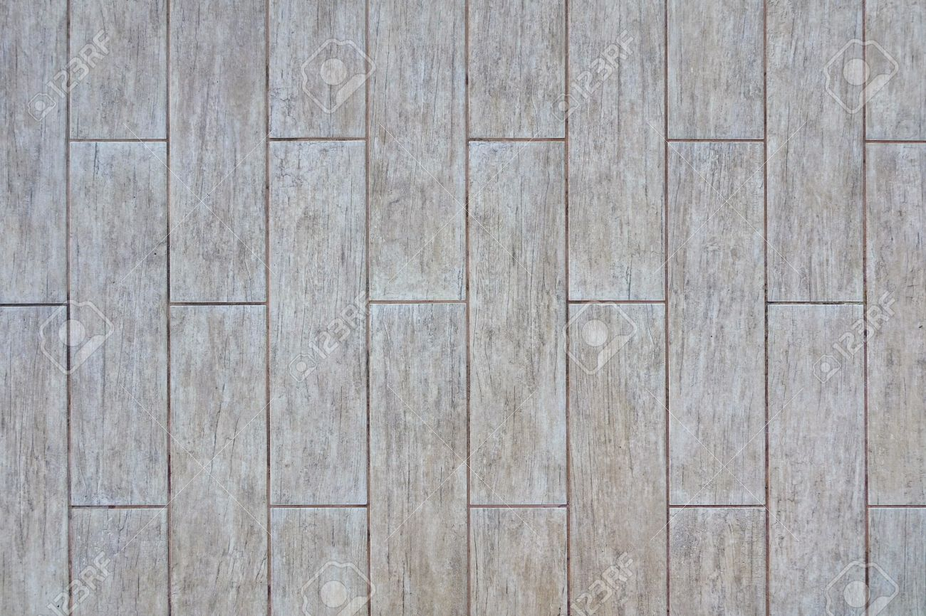 Ceramic Parquet Floor Tiles With Natural Ash Wood Textured Pattern Background Or Wallpaper With Copy