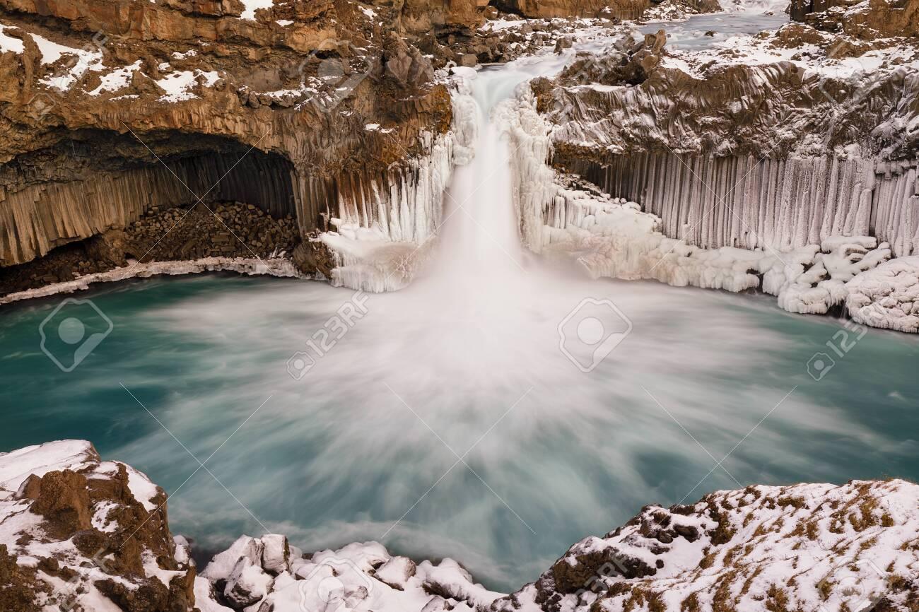 Aldeyjarfoss, icelandic waterfall rounded by basalt columns - 135369975