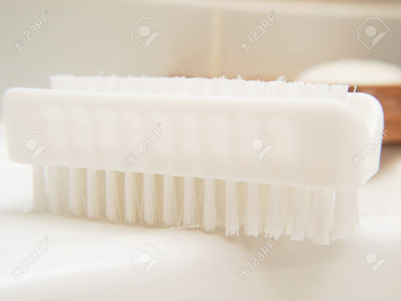 White nail brush, in bathroom, on sink, hygienic Stock Photo - 13040571