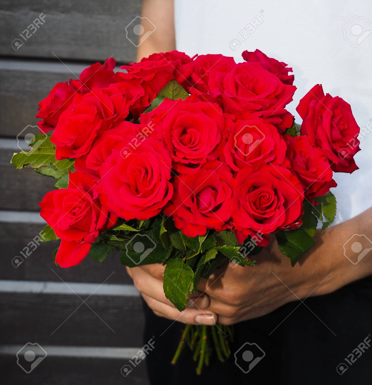 Male Person Holding A Beautiful Bouquet Of Red Roses Wearing.. Stock ...