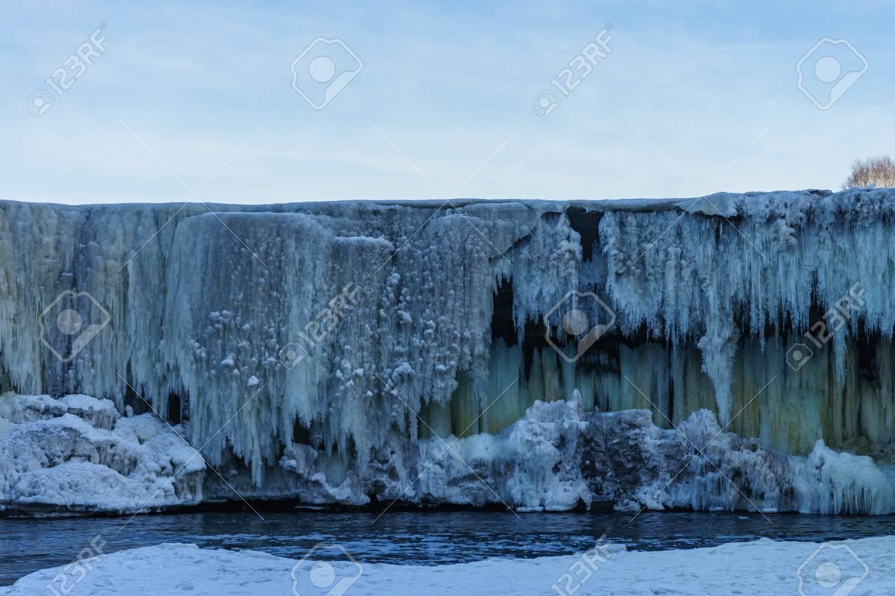 123RF.com & Frozen waterwall Jagala river in the Estonia