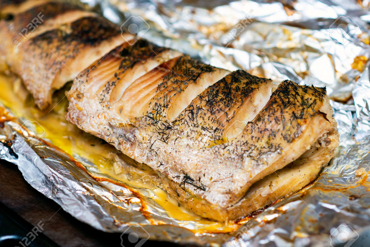 lying down fish cooking in the oven, pike lie in a foil - 156541943