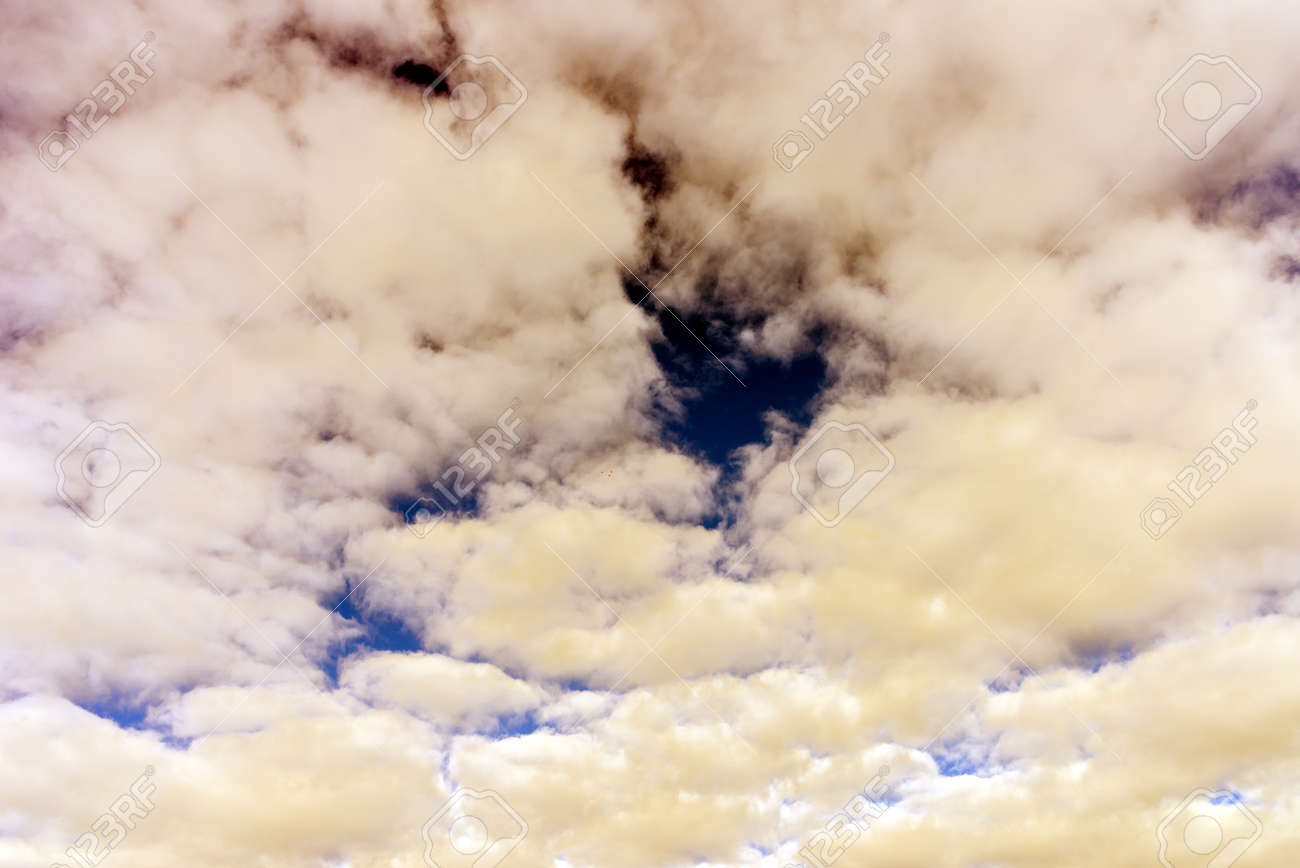 Cloud and blue skay background.Dramatic nice white clouds on a blue heaven.Toned. - 164874364