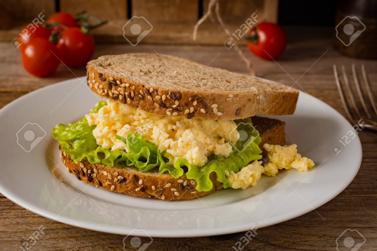 Scrambled Eggs On Whole Wheat Toasted Bread With Green Salad Healthy Breakfast Or Snack Stock