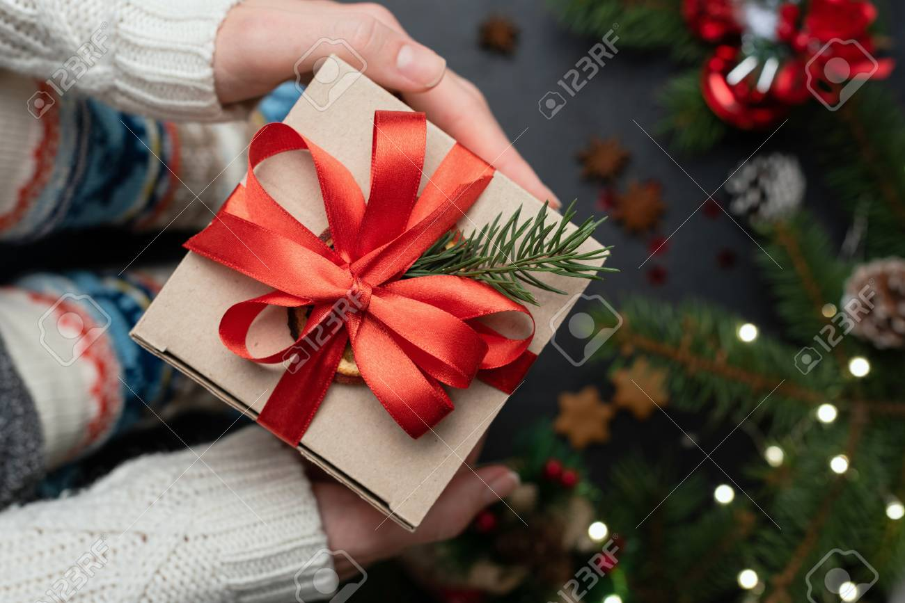 Christmas Tree Top View.Holding Christmas Or New Year Gift Box Under Christmas Tree