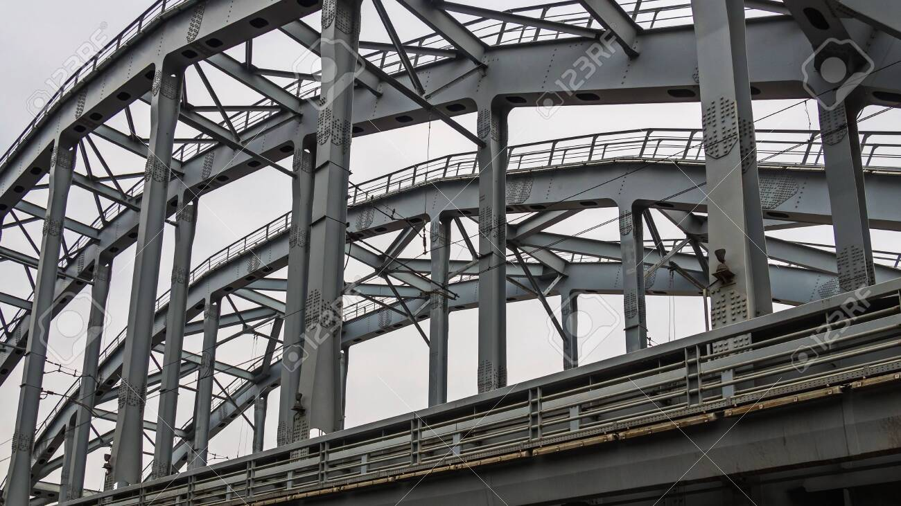 Poetry of metal structures of St. Petersburg. View of American bridges from the sidewalk. - 142252709