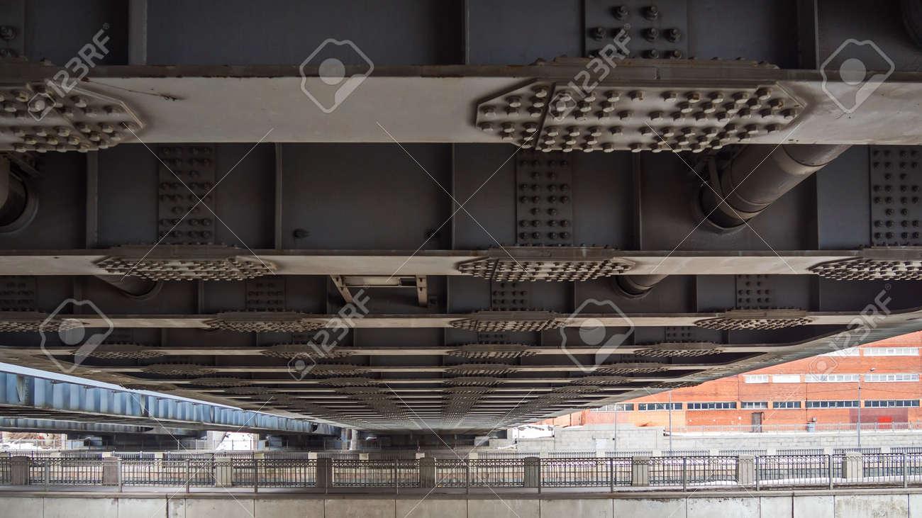 Poetry of metal structures of St. Petersburg. View of American bridges from the sidewalk. - 118779434