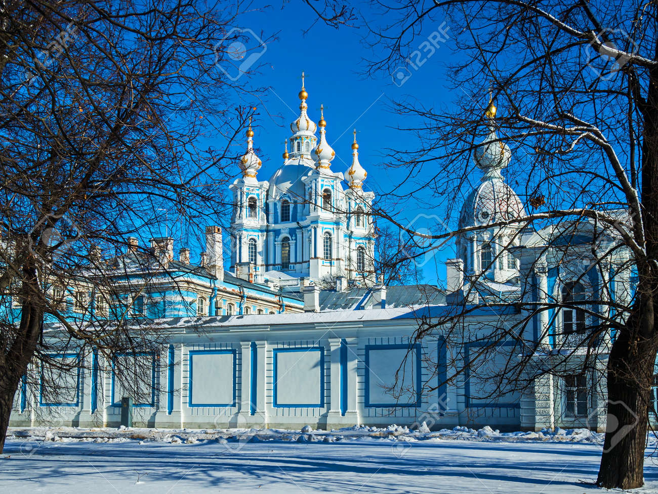 White Baroque lace on the blue facades of Rastrelli. Smolny Cathedral in St. Petersburg. - 118780686