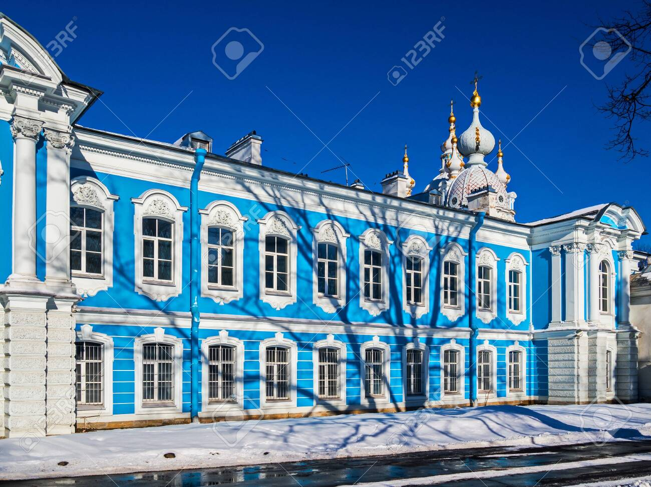 White Baroque lace on the blue facades of Rastrelli. Smolny Cathedral in St. Petersburg. - 118781990