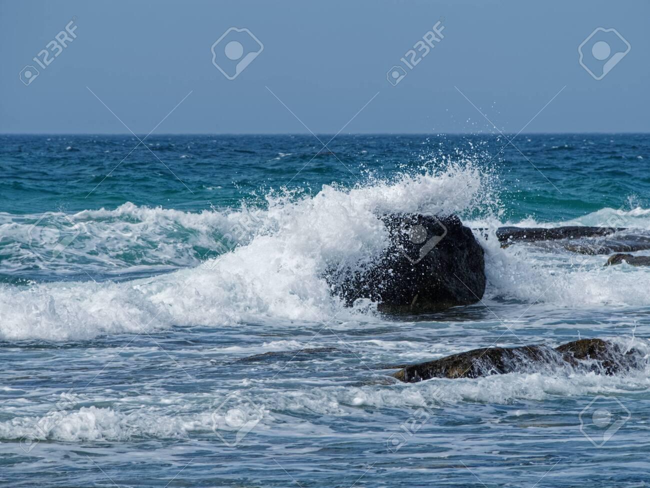 Game of sea waves on the coast of the Caspian sea. - 136880723