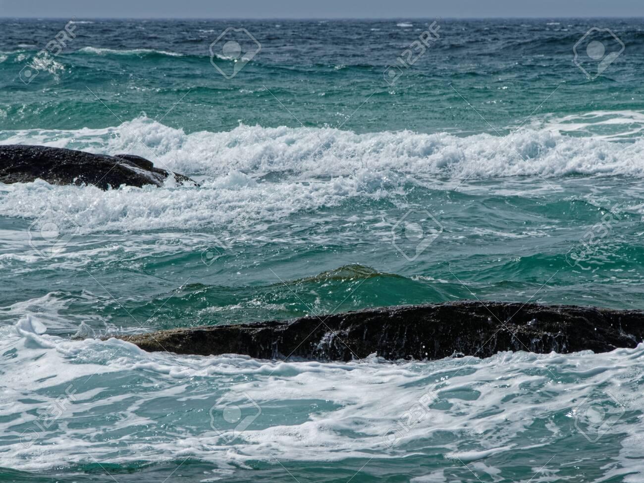 Game of sea waves on the coast of the Caspian sea. - 136880717