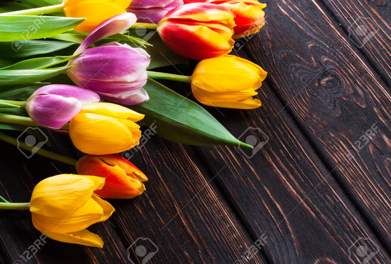 Bouquet tulip on wood background - 52685777