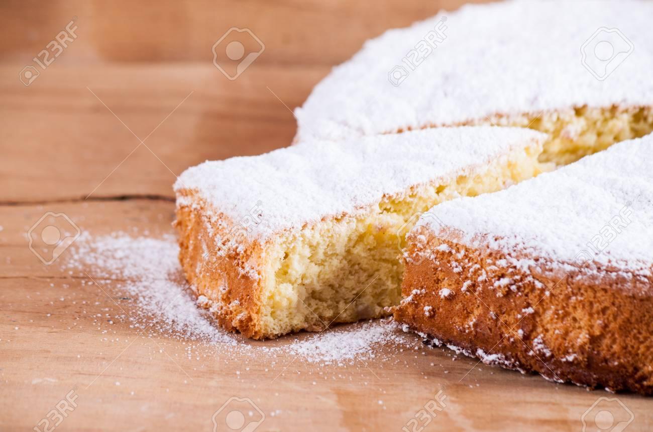 Sponge cake on wood board - 65044025