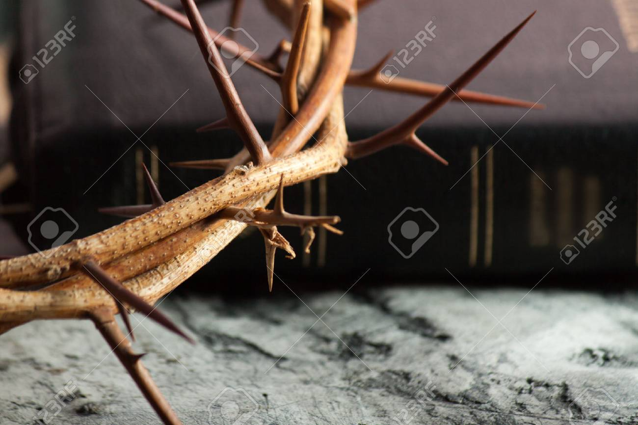 Crown of thorns and Bible on wood desk. Wood Cross. Concept love - 78671417