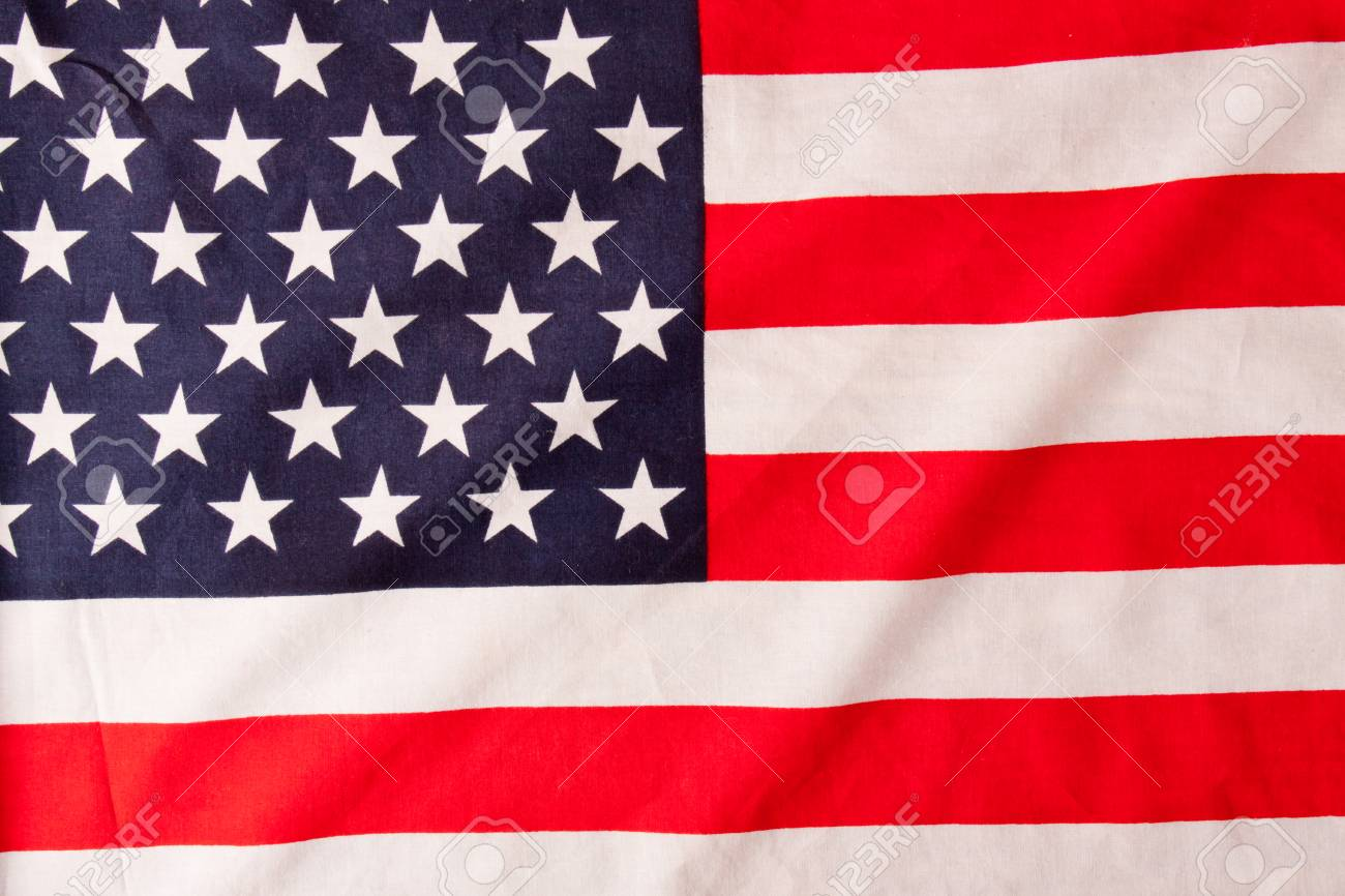 American Flag Close Up On Wood Desk Veterans Day Stock Photo