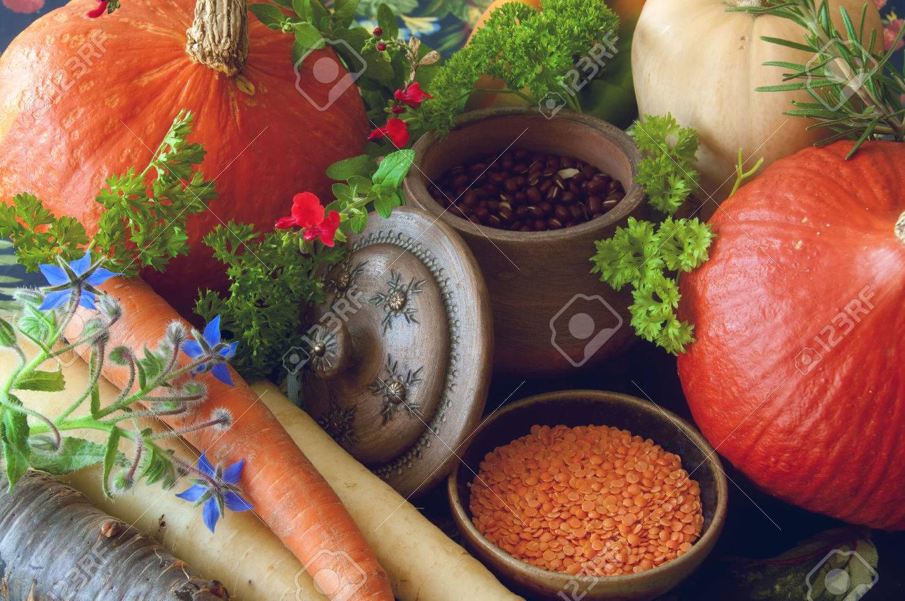 Pumpkins seeds butternut squash carrots and herbs Still life composition with seasonal vegetables of autumn - 40500466